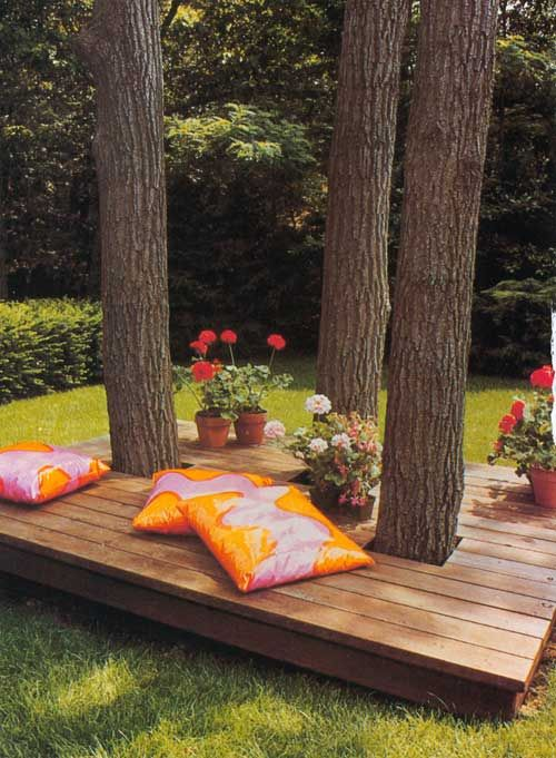 seated deck around trees in a kid friendly backyard poppytalk.blogspot.com